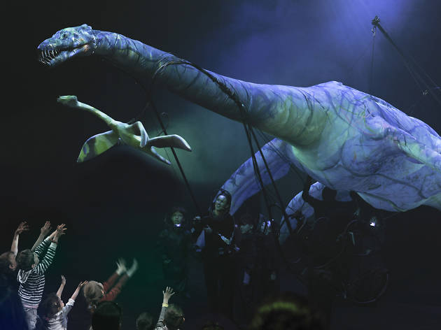 Prehistoric creature puppet with children