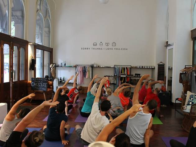 People doing yoga at the Sorry Thanks I Love You store