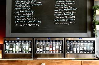 A self-serve wine machine and list