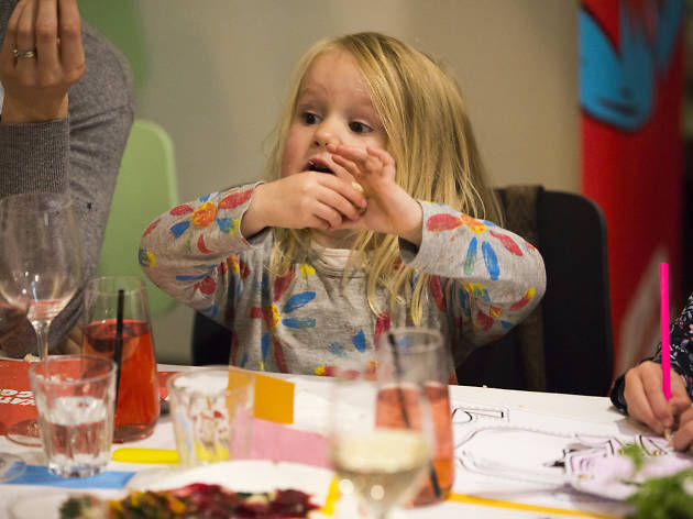 Child sitting at a dinner table