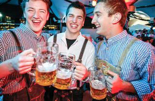 Men drinking steins of beer at Oktoberfest