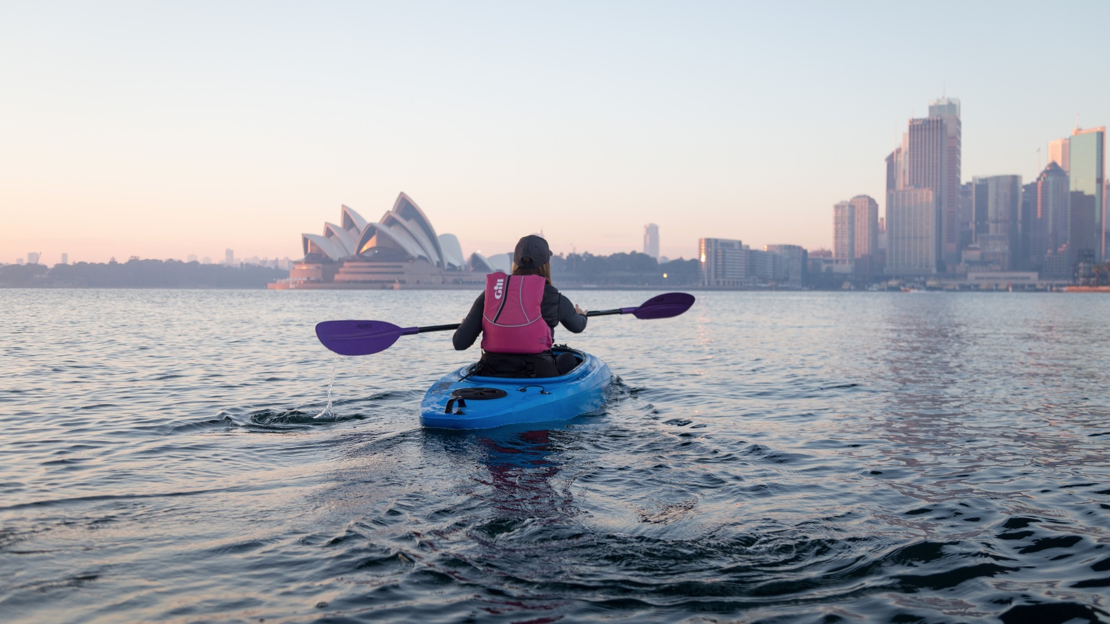 Person kayaking toward Sydney Opera House for Sydney by Kayak