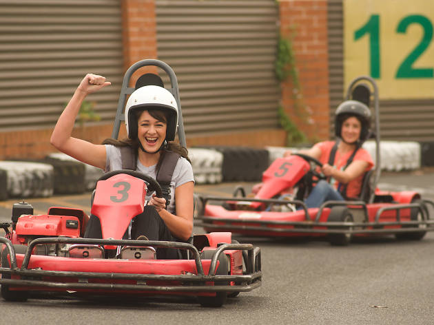 Two women in go karts