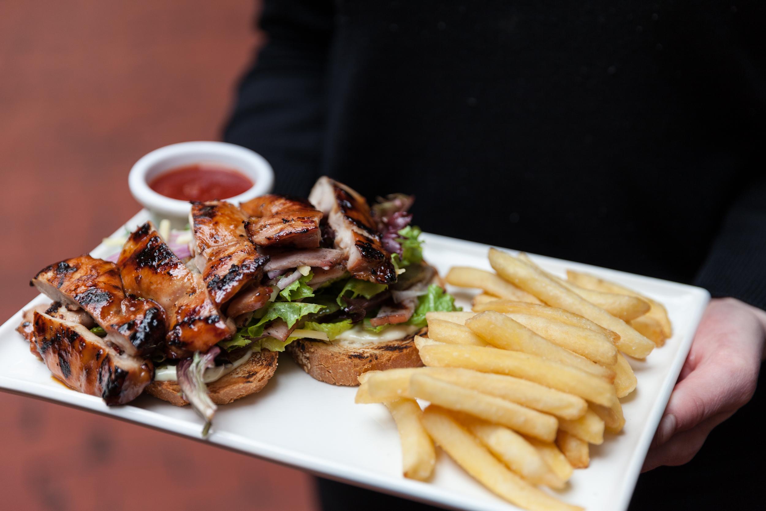 Grilled open chicken sandwich at The British Hotel