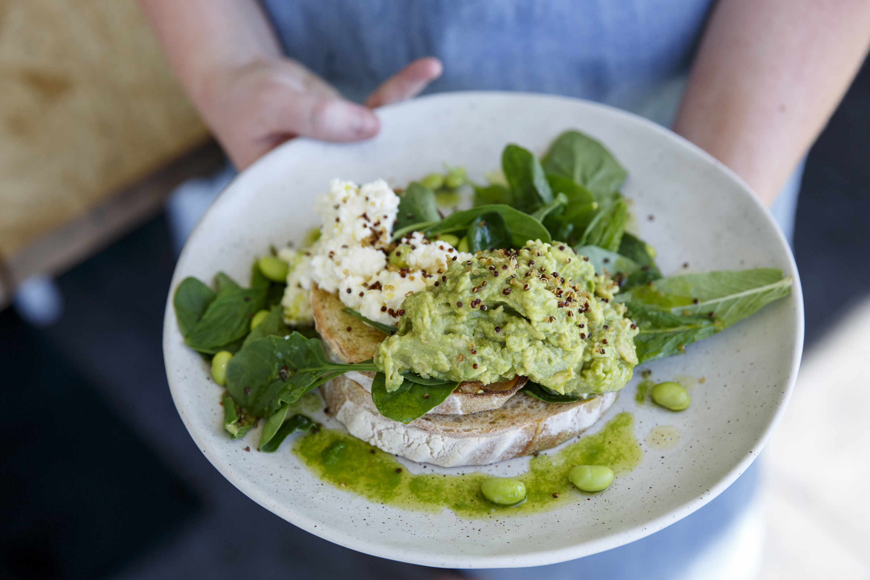 Smashed avo, edamame beans on toast, ricotta, mint and crispy quinoa at Bib & Tucker, $19
