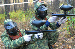 Generic paintball players prepare for fight