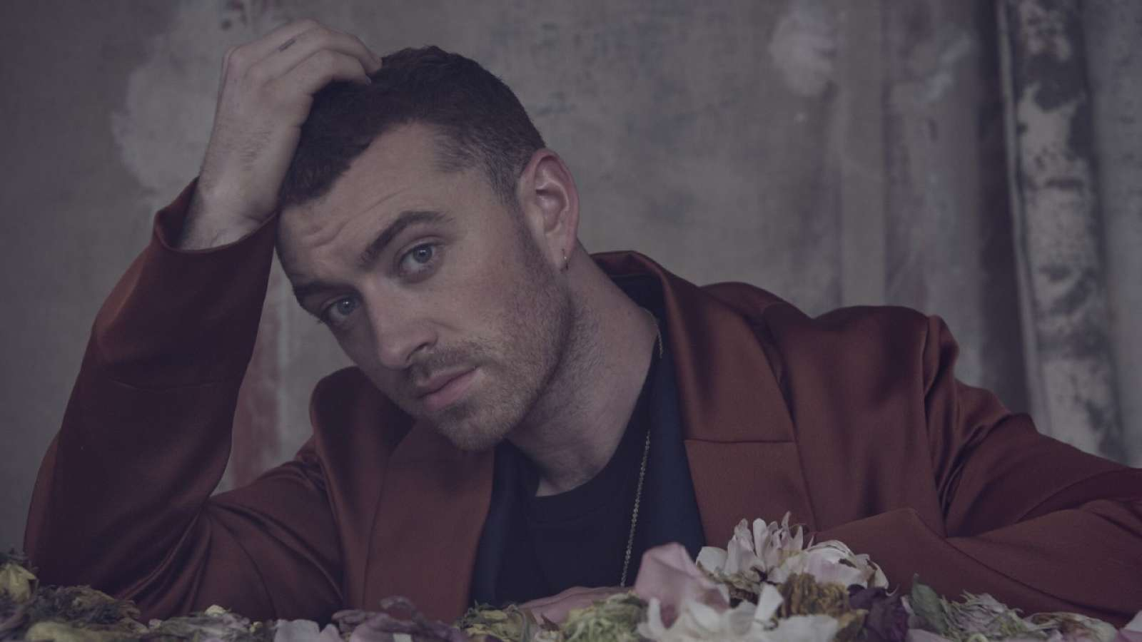 Sam Smith with hand on his head
