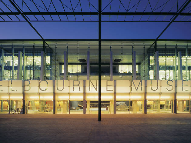 Melbourne Museum entrance at night showing glass facade