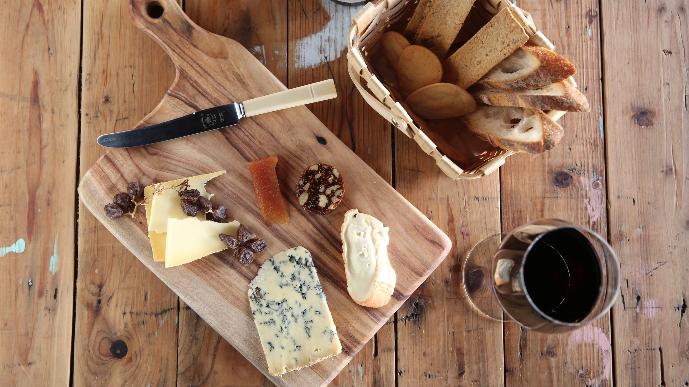 Cheese platter with red wine and bread at The Stinking Bishops