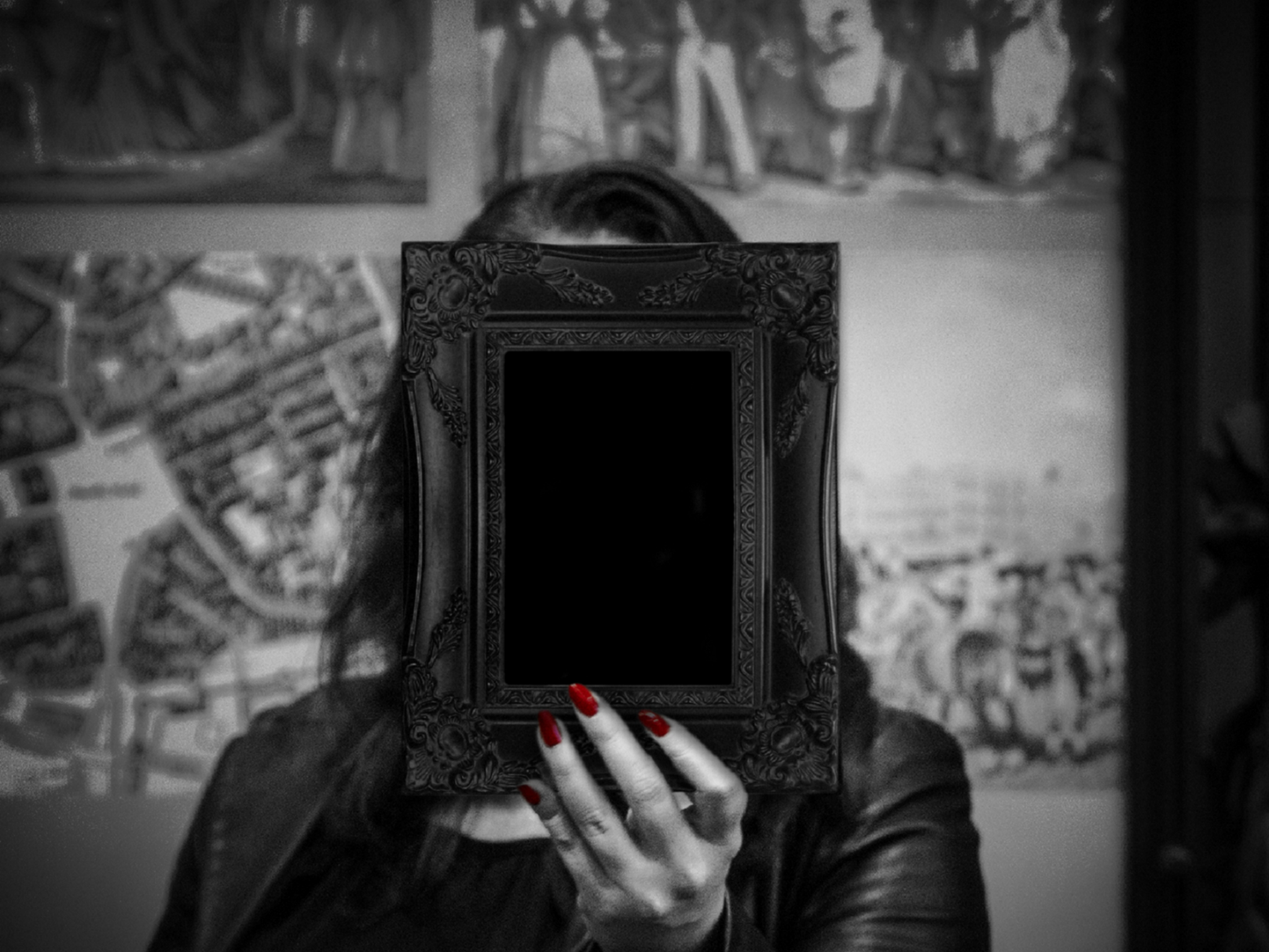 Woman holding up mirror