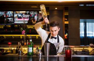 Bartender making cocktails at Sokyo Lounge