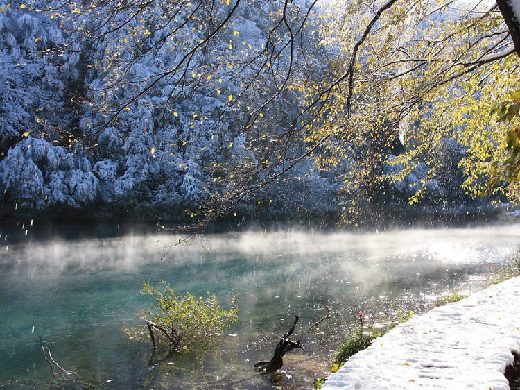 Admire the frozen waterfalls at Plitvice