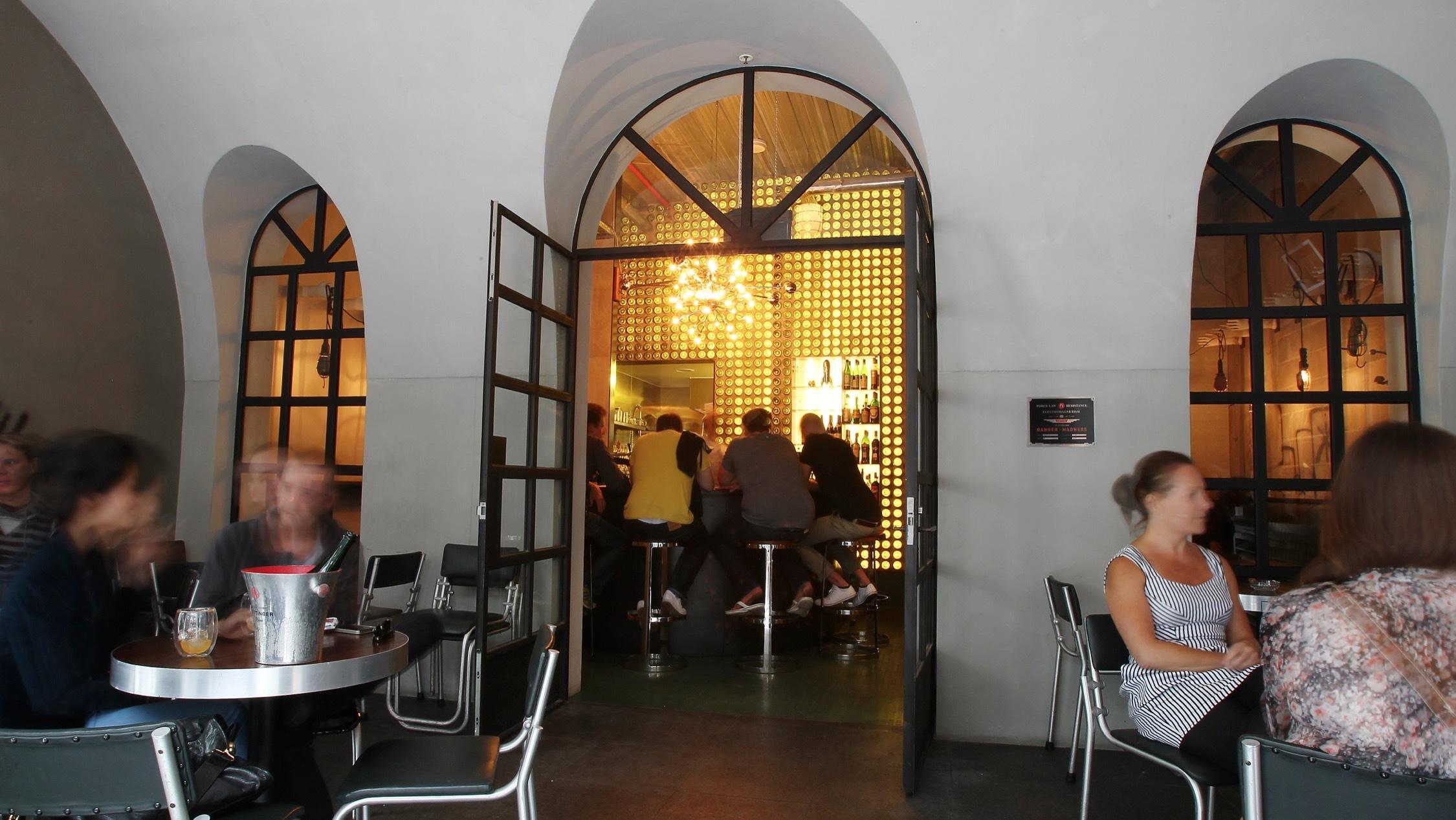 Customers drinking at Bar Ampere