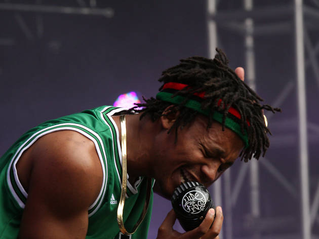 Lupe Fiasco singing into a microphone