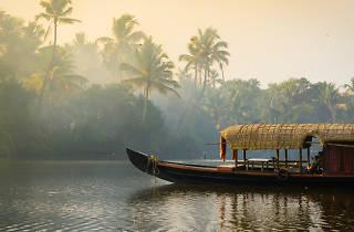 Boat floating down Kerala river