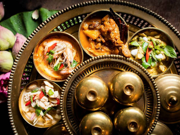 An array of Thai dishes on a brass plate