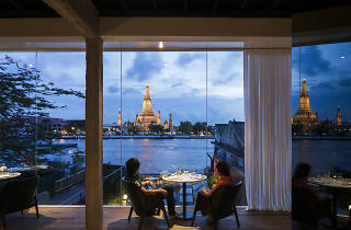 Diners overlooking the water from a Bangkok Restaurant