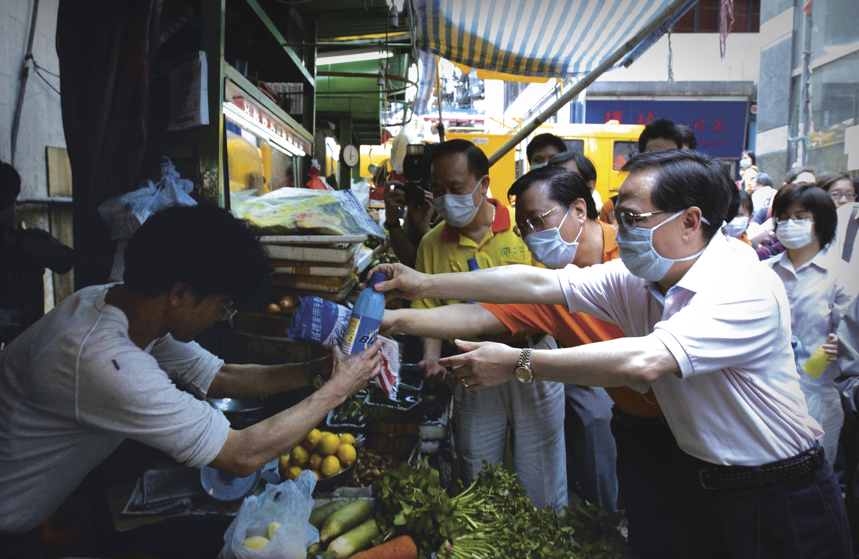 Donald Tsang, then Chief Secretary for Administration, visits the market