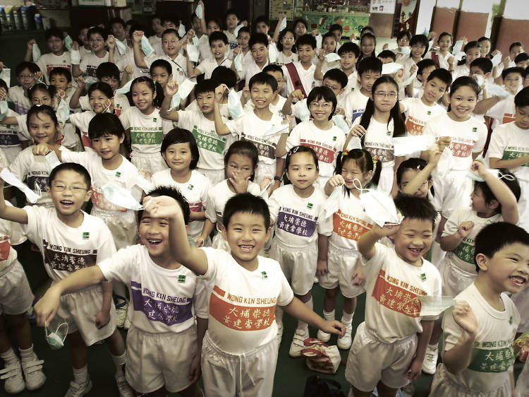 Children celebrate Hong Kong's removal from the list of infected areas