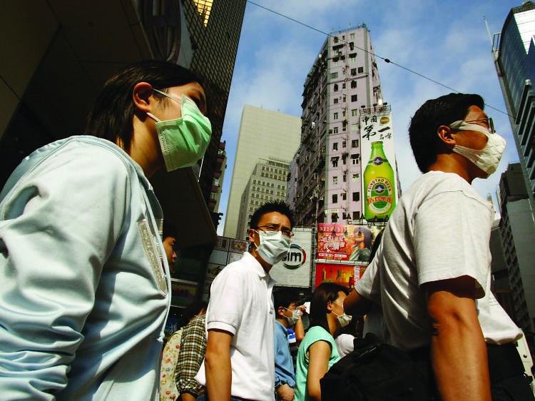 Causeway Bay is a sea of masks as SARS hits its peak