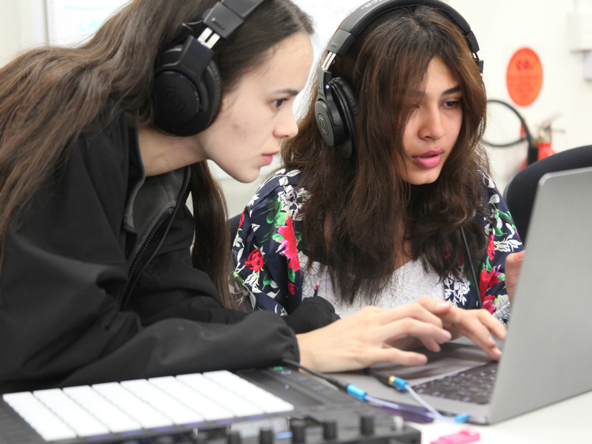 Girls at a an electronic music workshop