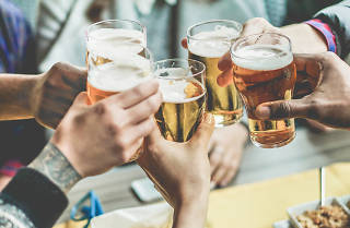 Group clinking beer glasses