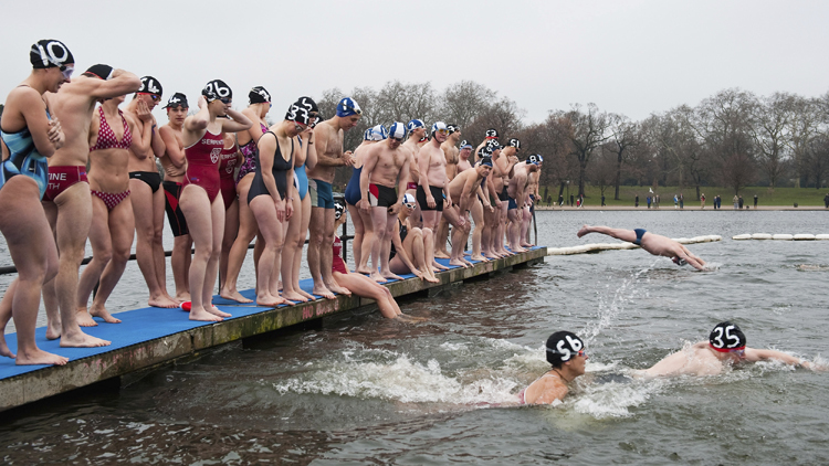 Swimmers Compete For The Peter Pan Cup In The Icy Waters Of The Serpentine