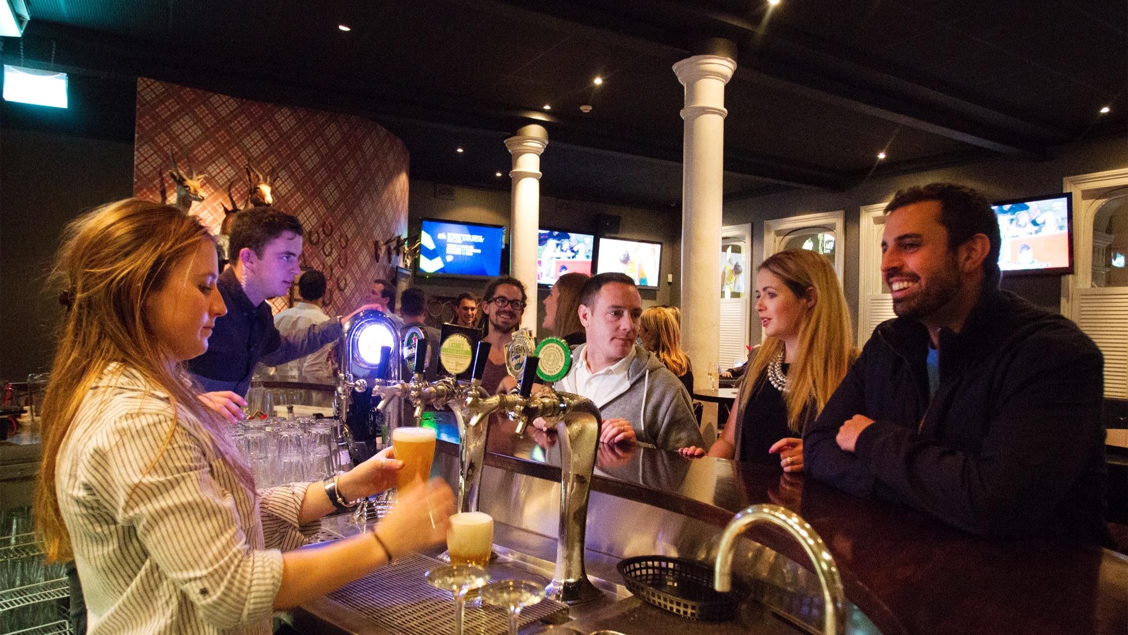 Customers having drinks at York 75