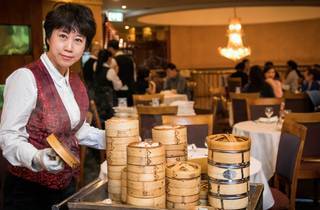 Lady serving yum cha at Palace Chinese Restaurant