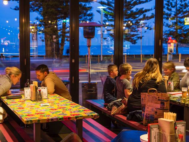 Customers with view of Manly Beach at Daniel San