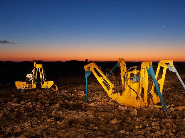 Two of James Capper's yellow sculptures in Broken Hill