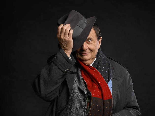 Barry Humphries poses with a hat