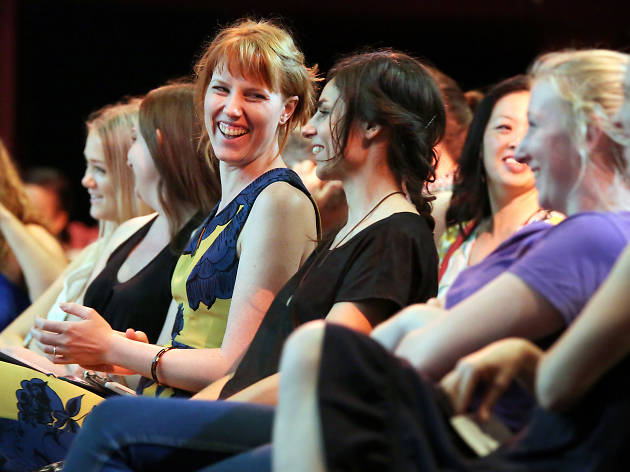 Women laughing together in the audience