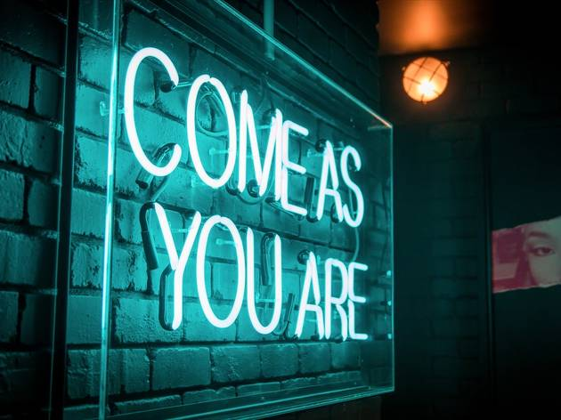 Neon sign 'Come as you are' at Kid Kyoto Sydney