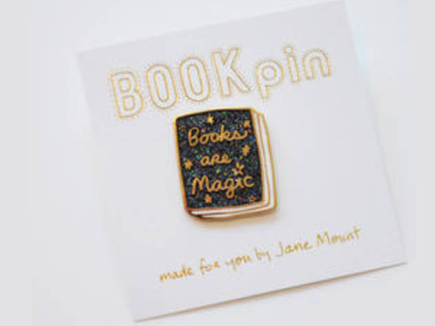 A tote bag and pin from Books Are Magic