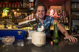 Bartender making an Appletiser cocktail at Lost Luau