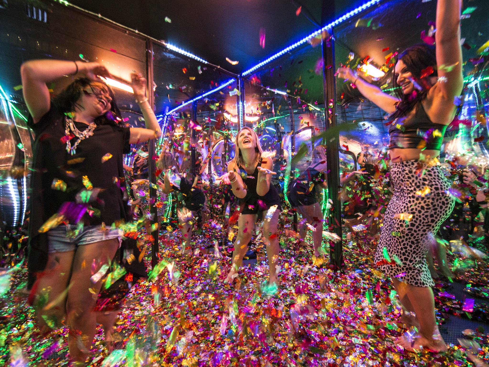 Women dancing in glitter