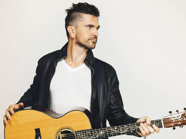 Juanes holds and acoustic guitar