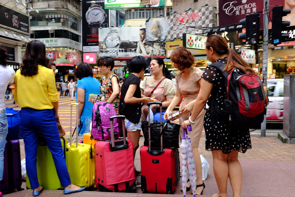 Mainlanders with suitcases