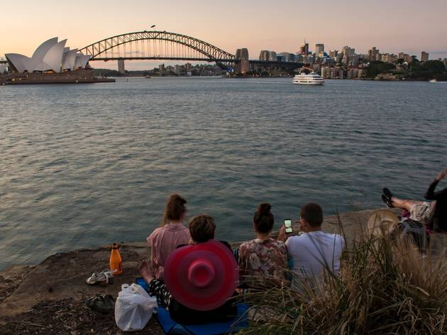 People having a picnic with view of Sydney Harbour at Mrs Macqua