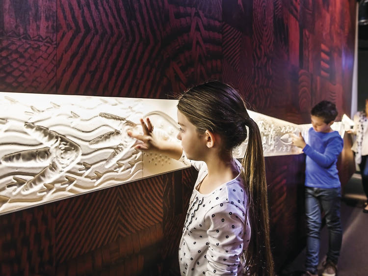 Learn stories of the traditional owners at the Bunjilaka Aboriginal Cultural Centre