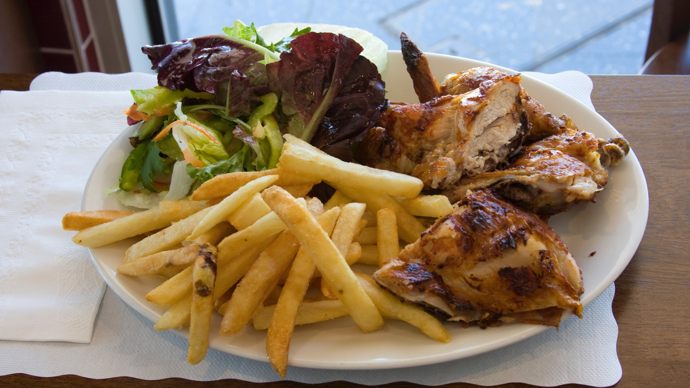 Chicken chips and salad at Sivas Portugese Charcoal Chicken Pete