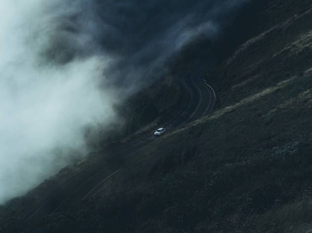 A car drives through the Marin Headlands