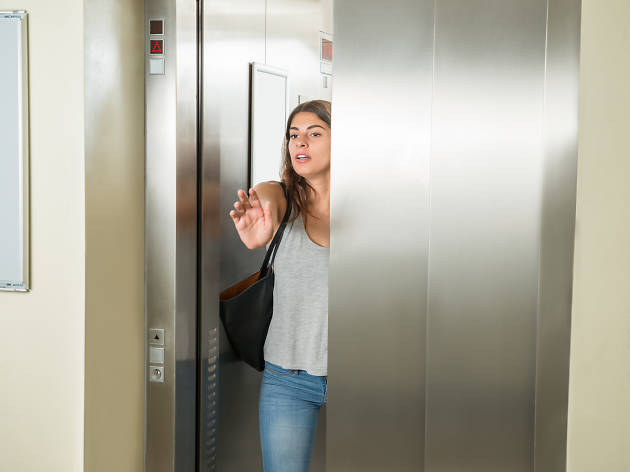 Woman trying to catch the elevator