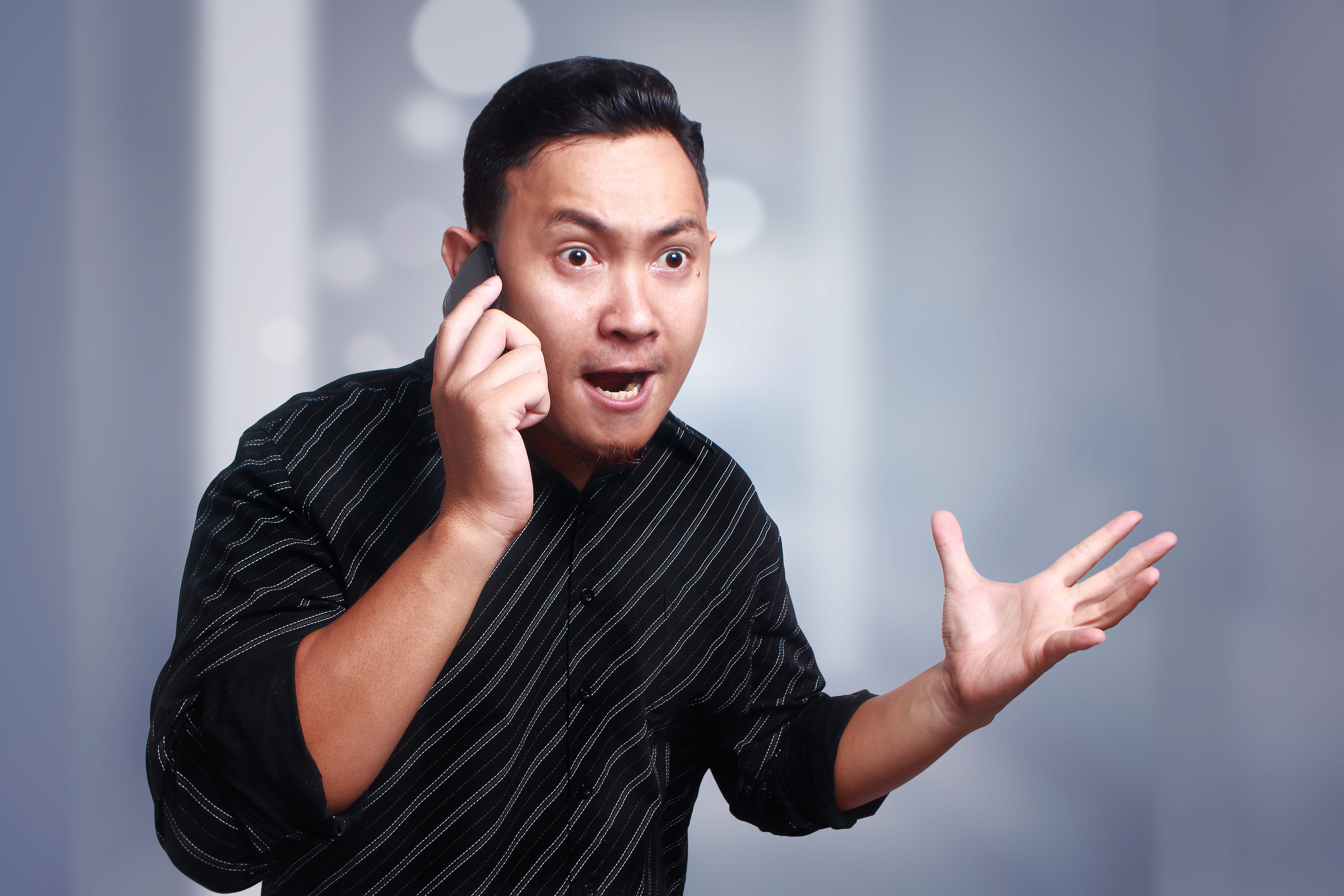 Man angry on the phone