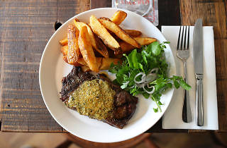 a plate of steak and chips