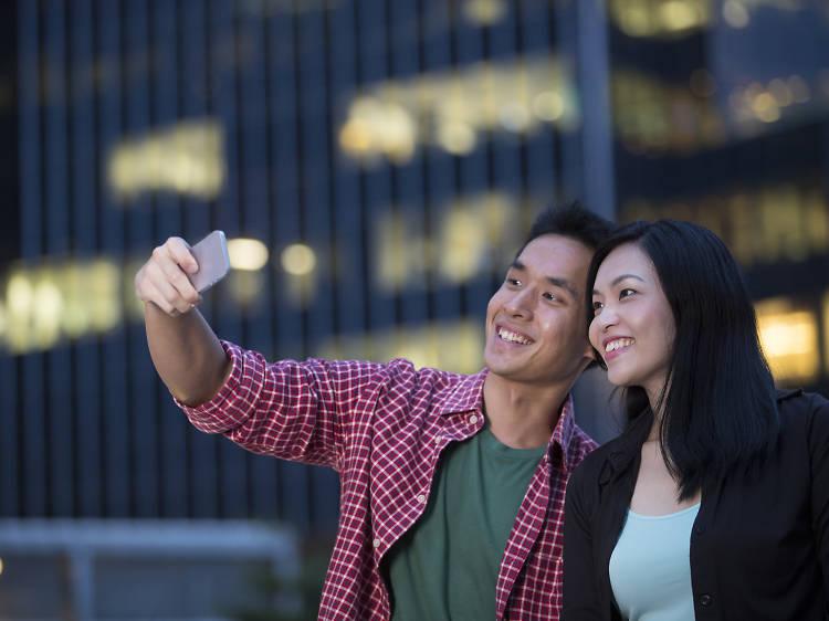 Couples taking selfies. Everywhere