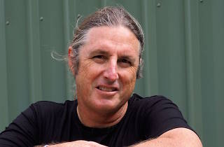 Tim Winton posing for a press photo