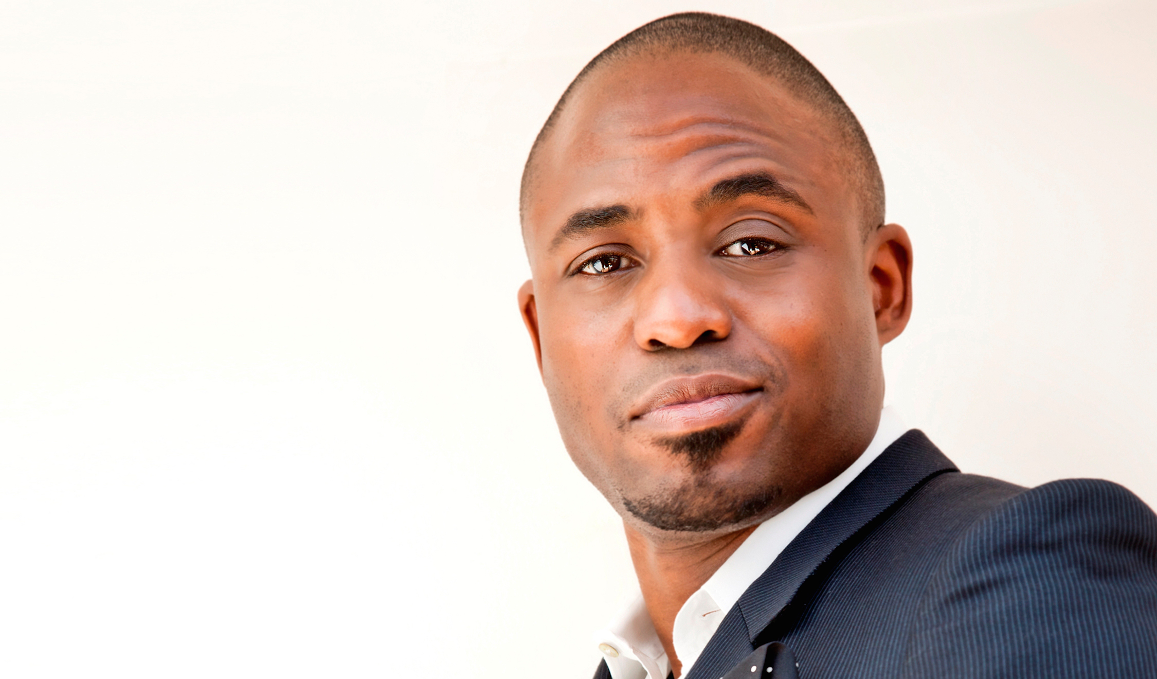 Wayne Brady poses for a press shot