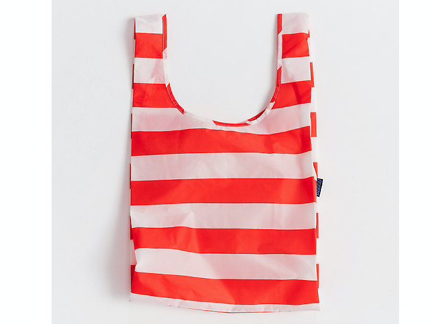 Double-duty beach tote that folds neatly in your clutch for those impromptu trips to the sand